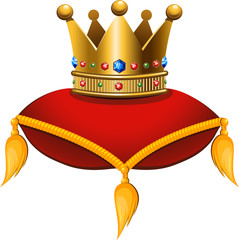 Gold crown on a crimson cushion