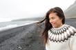 Beautiful woman walking on beach on Iceland