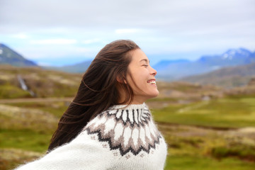 Free happy woman on Iceland in Icelandic sweater
