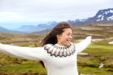 Happy free woman on Iceland in Icelandic sweater