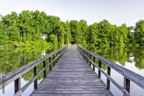 Pond in Alabama and wooden foot bridge