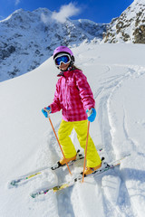 Skiing, skier on ski run - child skiing downhill