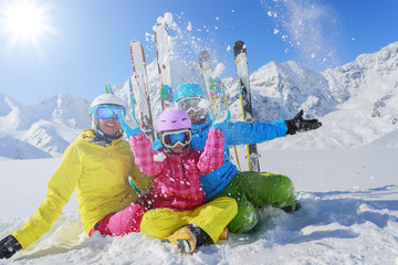 Skiing, winter, snow, skiers enjoying winter vacation