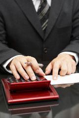 businessman calculating expenses