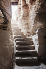 stone staircase leads up from