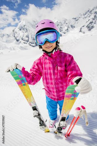 canvas print picture Ski, winter fun - lovely skier girl enjoying ski vacation