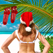 Woman in bikini on a beach at christmas