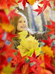 Autumn - young girl enjoying autumn