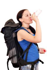 beautiful girl hiker drinking water