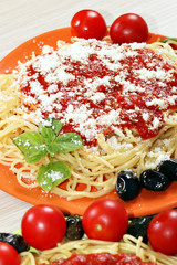 spaghetti with tomatoes cheese and sauce