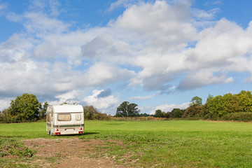Abandoned Caravan in Field