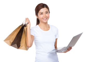Woman use laptop and shopping bag