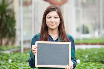 Female Garden Worker Holding an blank chalkboard