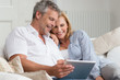 Happy Mature Couple With Tablet - 71163419