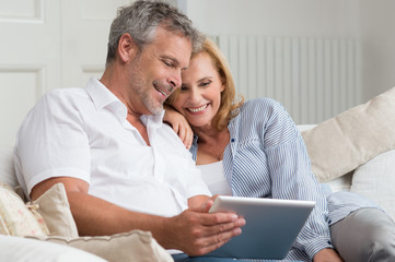 Happy Mature Couple With Tablet