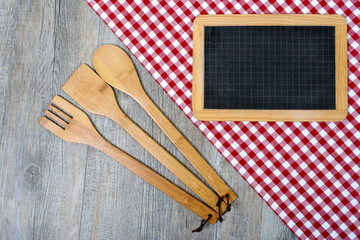utensils for cooking wood with a small blackboard