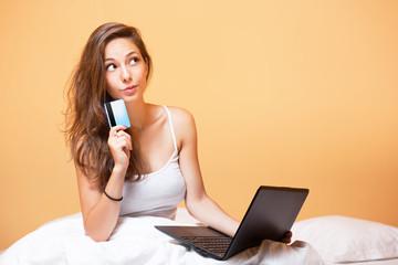 Gorgeous brunette using laptop.