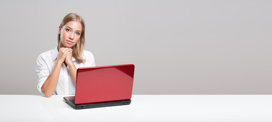 Blond beauty using laptop.