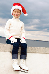 Portrait of a smiling girl in a Christmas skating