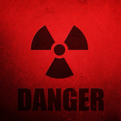 Danger. Radioactive environment sign on rusty red background