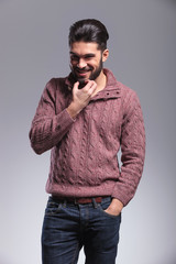 young fashion man scratching his beard