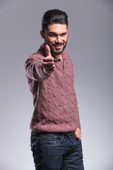 young fashion man showing the thumb up gesture