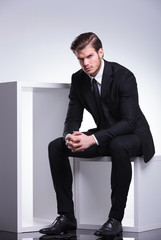 business man sitting on a white table