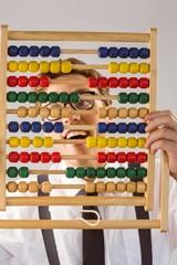 Geeky businessman using an abacus