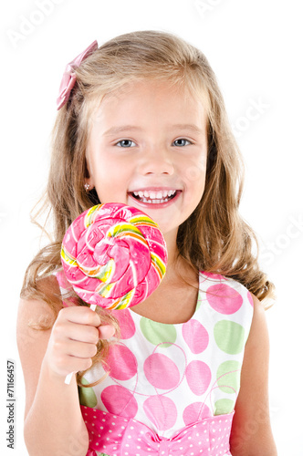 canvas print picture Happy little girl with lollipop isolated on a white