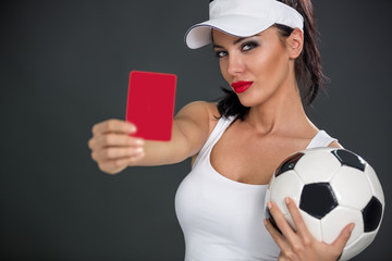 Young attractive woman showing  red card