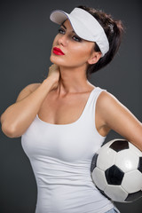 Attractive babe with soccer ball