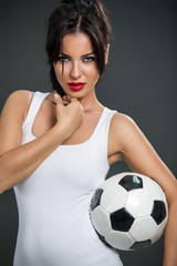 woman posing with soccer ball