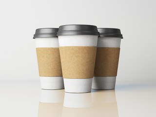 Three white paper cups with black caps. With reflections