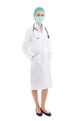 full length young woman doctor in mask and cap isolated on white