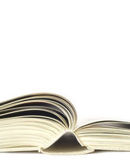 Open book close up, isolated on white background