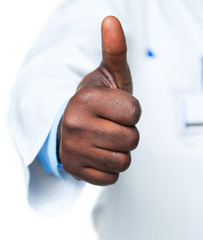 Doctor with finger up on white