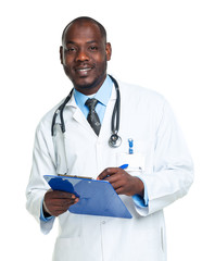 Portrait of a smiling male doctor writing in the notepad on whit