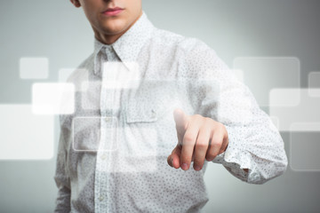 Businessman pressing application button on computer with touch s