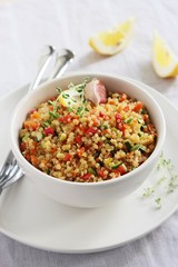 Quinoa salad with vegetables,herbs and lemon.