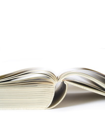 Open book close up, isolated on white background, free copy spac