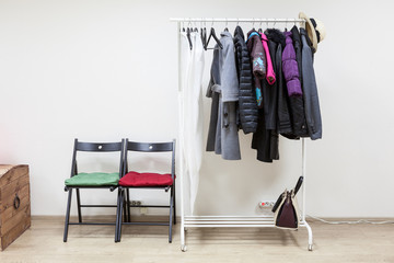 Hanger with outerwear in the interior hallway room