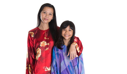 Asian Malay mother and daughter in traditional dress
