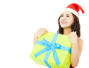 smiling young woman looking forward with christmas gift box