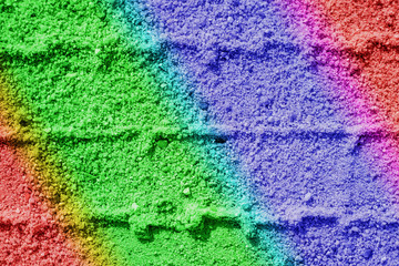 Regenbogenfarben im Sand
