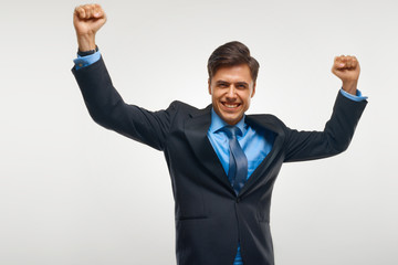 Business Man Celebrating Success against White Background