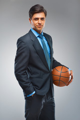 Businessman with ball against gray background