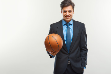 Happy Businessman with  ball against white background