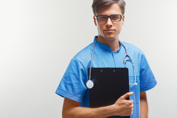 Doctor With Stethoscope Around his Neck Against Grey Background