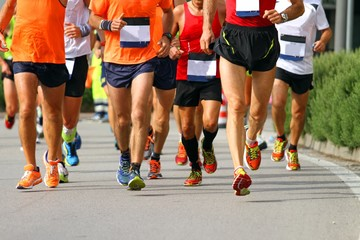 muscular legs of athletes engaged in long marathon