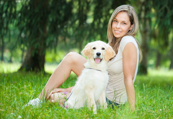 Woman playing with her her golden retriever outdoors